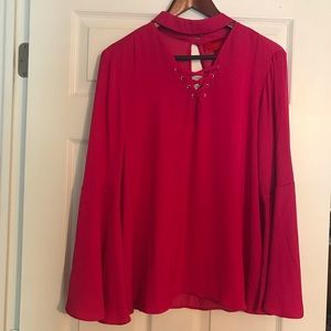 Hot pink Jennifer Lopez top with bell sleeves